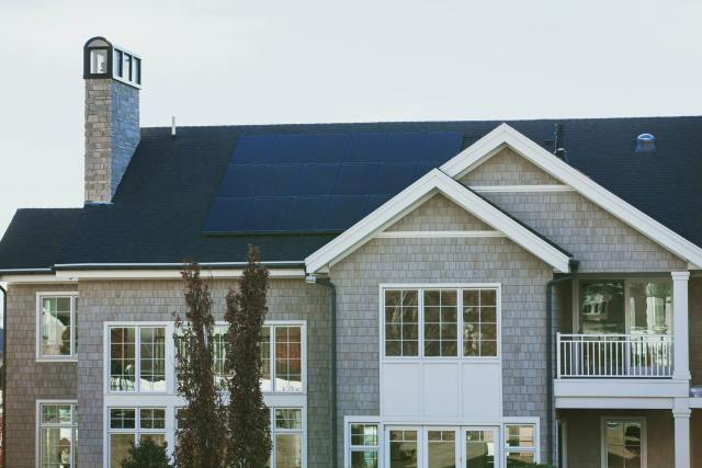 Grey house with solar panels