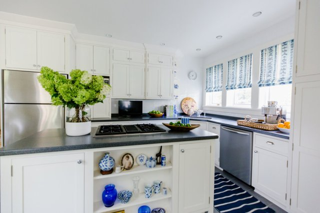 Decorated kitchen with vases and flowers in the kitchen island