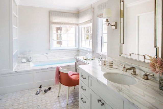 Master bathroom with orange and white sink and mirror