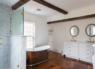 Bathroom with designed bath tub, mirror and sink
