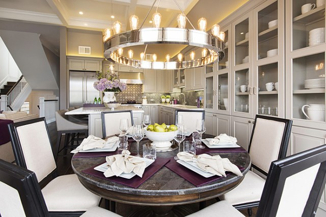 Round dining table, chandelier, and chairs