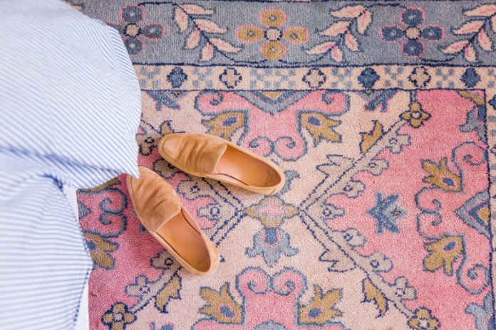 Rug with leather shoes