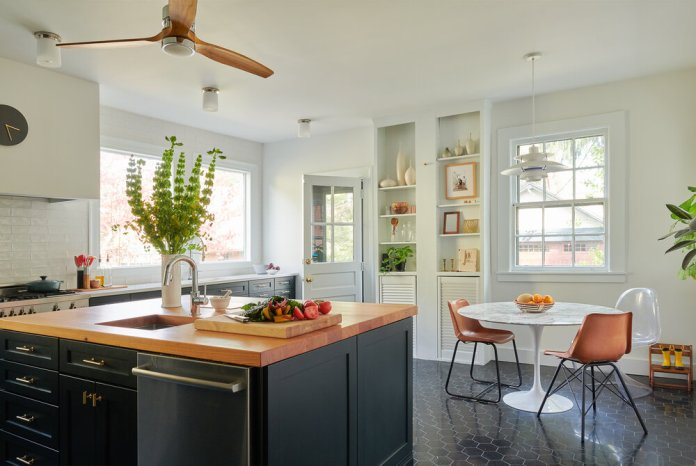 Kitchen and dining room designed in bright and dark colors