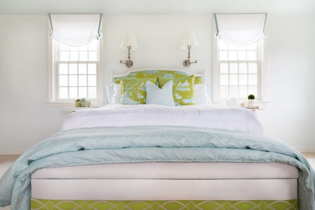 Bright-designed bedroom with double bed