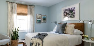 Bedroom with blue walls and double bed
