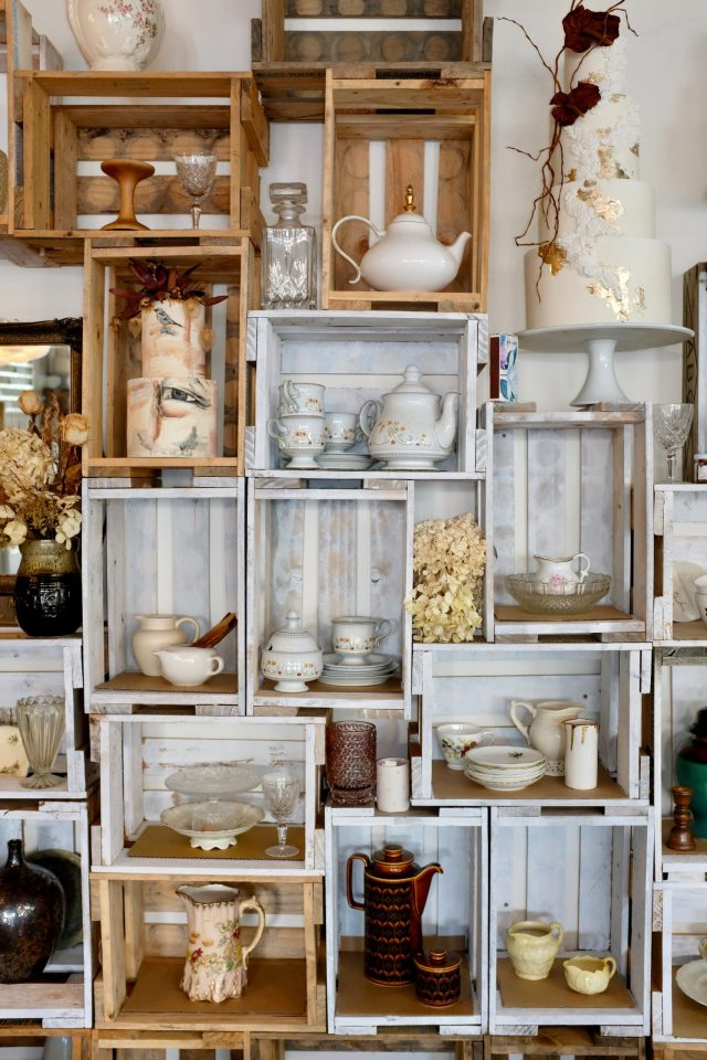 Teapots and cups on the DIY shelfs