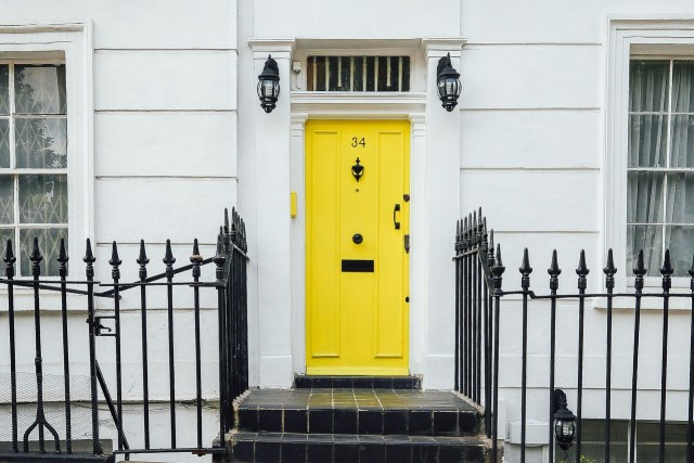 Yellow entrance door on the white house