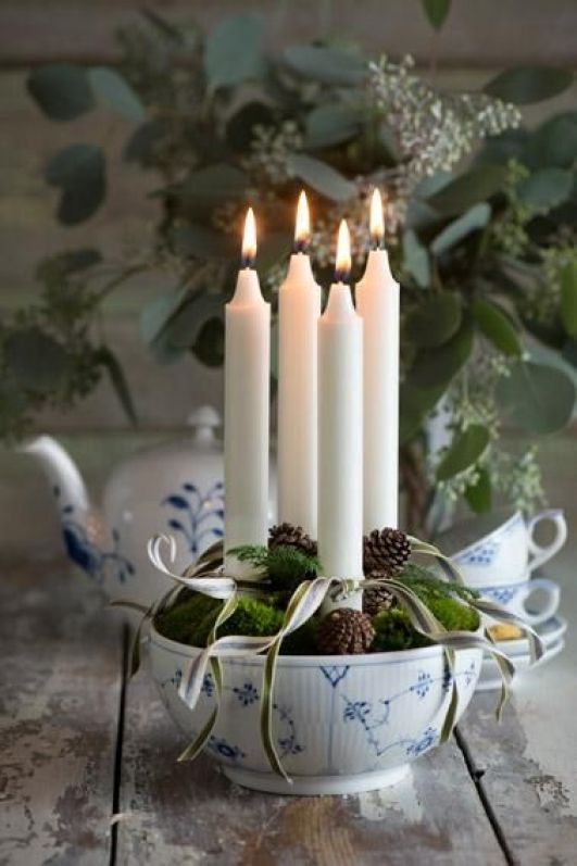 Bowl and 4 candles with greens and ribbon.