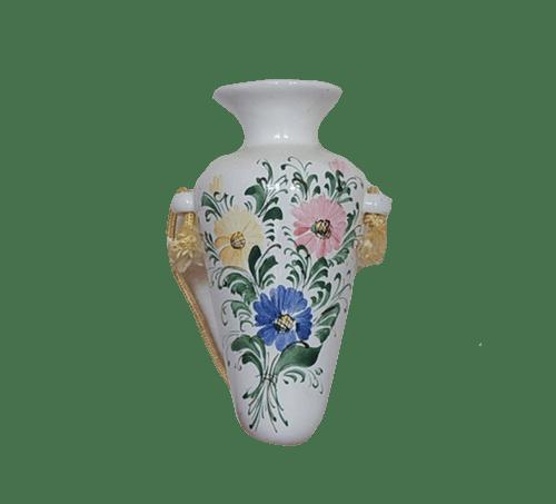 witte wand vaasje bloemen
