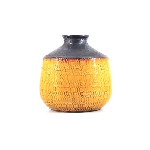 gele vaas bruine bovenkant