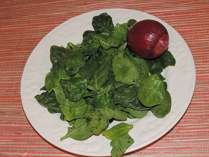 Rinse spinach leaves and chop