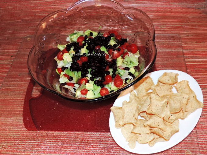 Add veggies and black beans into a bowl
