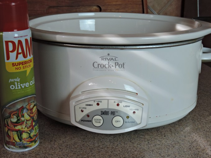 spray inside of crock pot with cooking spray