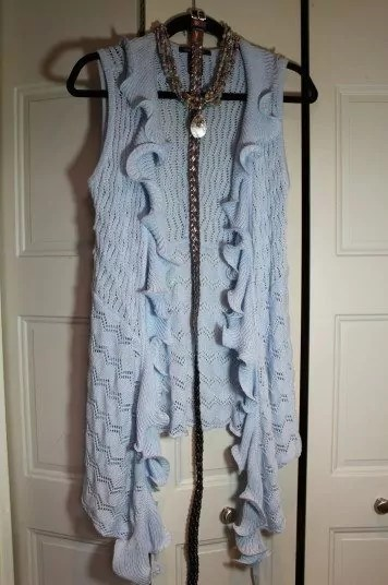 Thrifted light blue ruffled vest