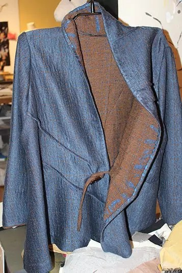Double-sided wool coat with details
