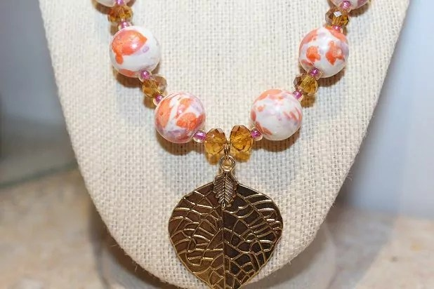 Ceramic, glass and metal necklace