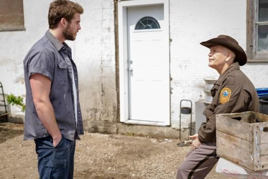 """Liam Hemsworth & John Malkovich in """"Cut Bank"""" (A24 Films)"""