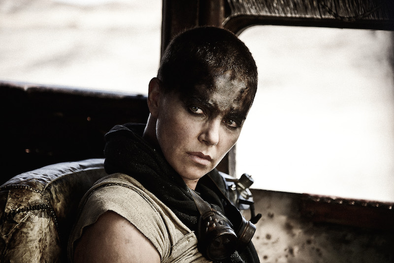 "CHARLIZE THERON as Imperator Furiosa in Warner Bros. Pictures' and Village Roadshow Pictures' action adventure ""MAD MAX: FURY ROAD,"" a Warner Bros. Pictures release.  Photo by Jasin Boland"