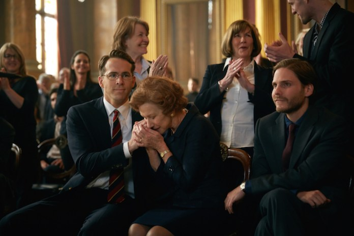 (L-R) RYAN REYNOLDS, HELEN MIRREN, and DANIEL BRUHL star in WOMAN IN GOLD