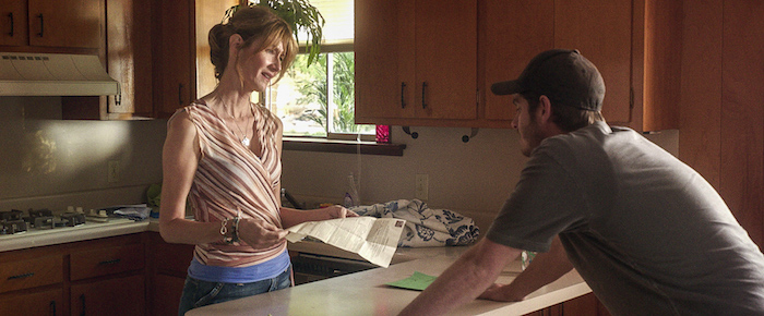 99HOMES_FP_03808 (l to r) Laura Dern stars as 'Lynn Nash' and Andrew Garfield as 'Dennis Nash' in Broad Green Pictures release, 99 HOMES. Credit: Broad Green Pictures