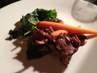 Lamb with baby carrots and spinach