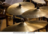 stock-photo-orchestral-cymbals-closeup-in-dark-colors-526387666