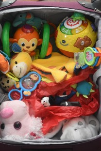 Pack a lot of toys and also carry a LOT OF snacks on board during a long haul flight with a toddler