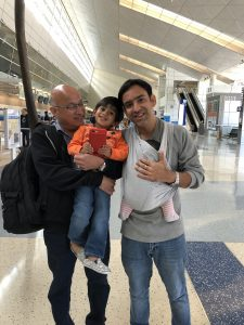 Father wearing newborn baby in Baby K'tan - review