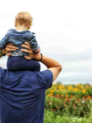 Baby on man's shoulders