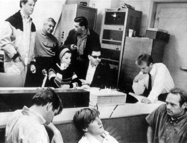 In the studio during the recording of the Monkey's Uncle theme song. Clockwise from top left: Brian Wilson, Tutti Camarata, Annette Funicello, Robert Sherman, Richard Sherman, Al Jardine, Mike Love, Carl Wilson and Dennis Wilson. (Photo: Disney)