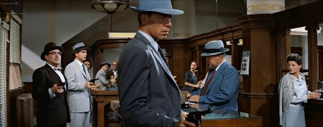 Bank robber Dill (Lee Marvin) at work in Violent Saturday. To his role Marvin 'brings a multi-faceted complexity to the role and gives a great example of the early promise that launched his long and successful career,' Film Noir of the Week.