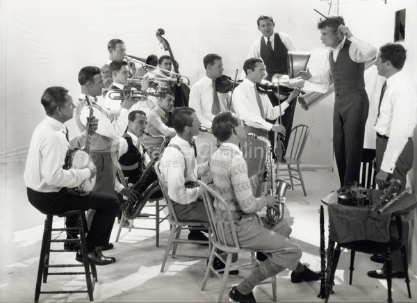 Charlie Chaplin conducting the Abe Lyman Orchestra. With the Lyman Orchestra Chaplin recorded two of his earliest records, 'Sing a Song' and 'With You, Dear, In Bombay,' both later used in the sound version of City Lights.