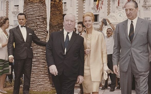 Alfred Hitchcock with Tippi Hedren at the 1963 Cannes Film Festival. Of her own claim that Hitchcock sexually assaulted her during the filming of The Birds, Ms. Hedren says now, 'I handled it at the time, and far as I was concerned, that was over. This sort of thing happens to every woman.'