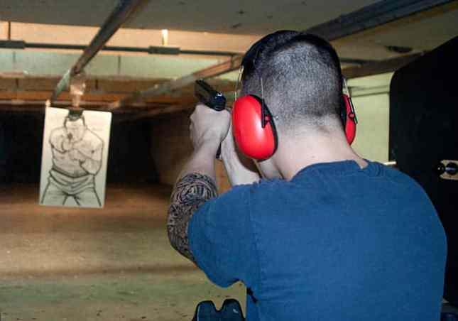 Young Man At Shooting Range