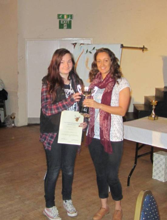 Chloe Tucker receiving the Young Clubman of the Year Award.