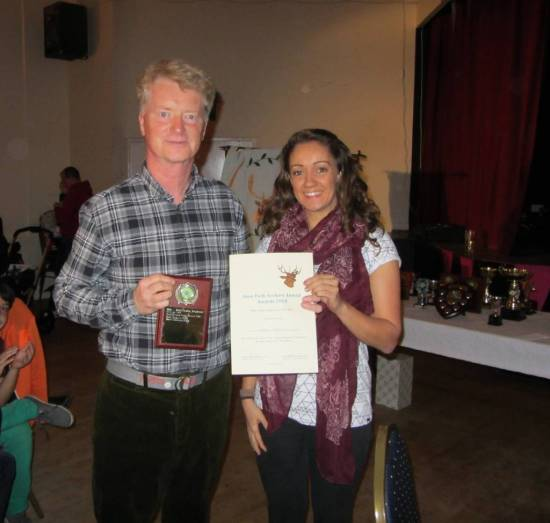 Dave Ponton receiving the 'Best Beginner' Award from Kirsty Dunleavy.