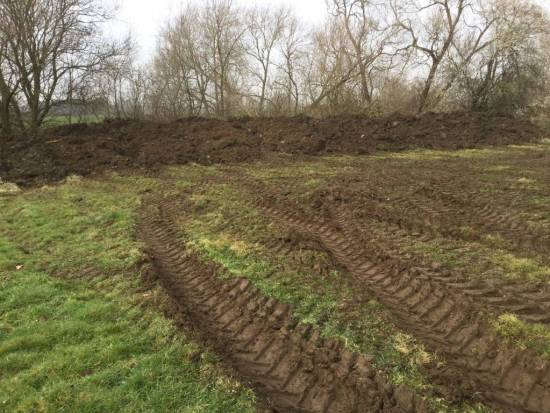 Removed soil forming a bank.