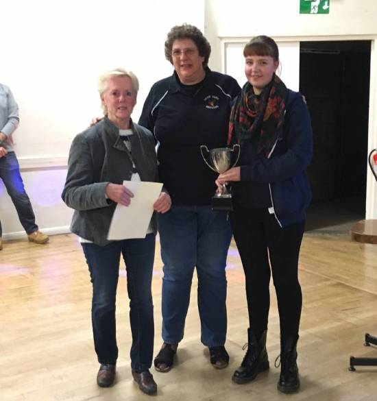 Lynn and Rosie Benfield present Mary Crang with the Clubman of the Year Award