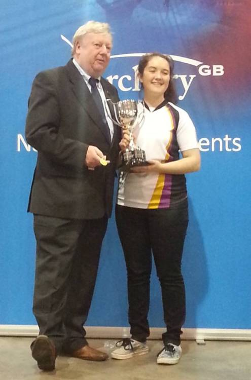 Lucy Mason receiving the Ladies Compound Trophy from Mr David Harrison - Chairman of Archery GB.