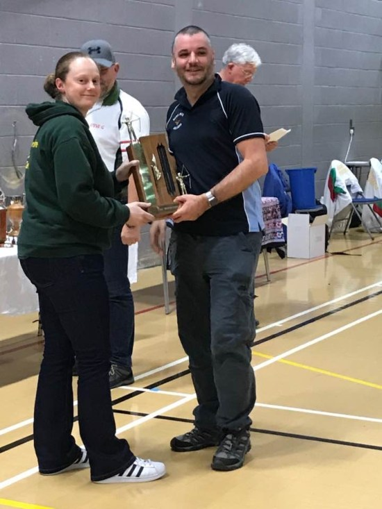 Ed Humphries receiving the Recurve County Trophy from Steph Gill