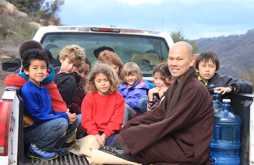 Monk and Children in truck at Deer Park Monastery