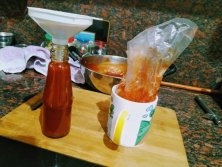 Fill homemade tomato sauce/ketchup in sterilized bottles