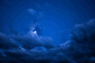 Print of the Moon, Clouds and Dark Blue Sky
