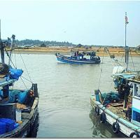 Azure boats of Mangalore fishermen