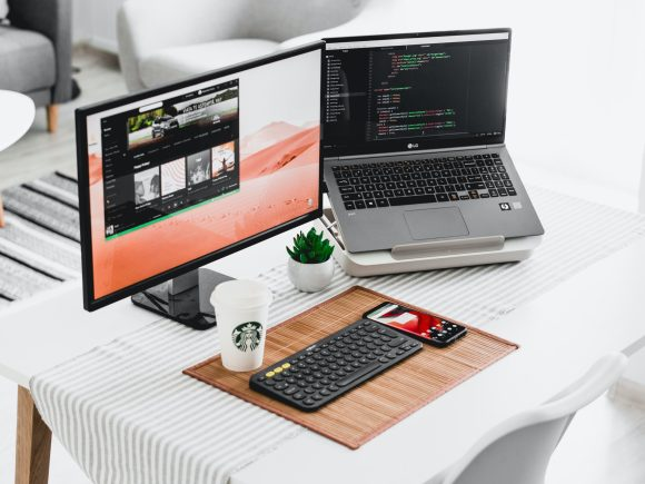Computer monitor connected to a laptop and keyboard
