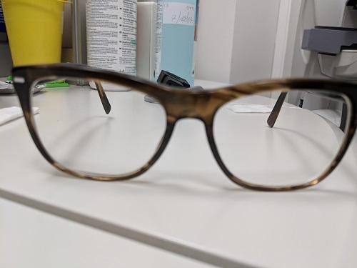 spectacle branch twist eye rubbing
