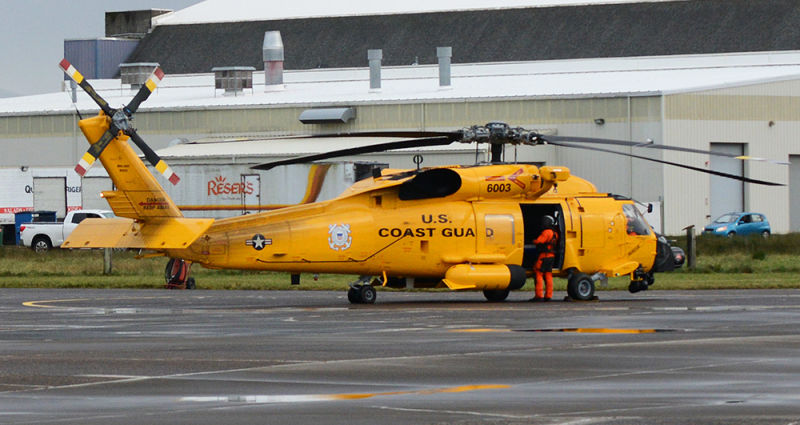 US Coast Guard MH60 Jayhawk helicopter with a yellow