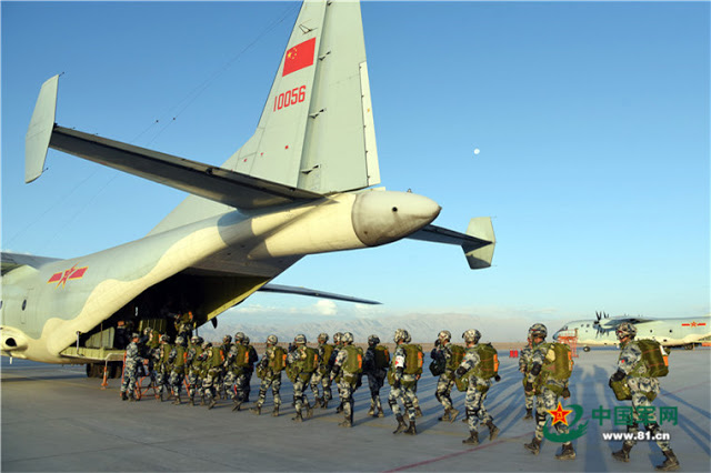 Chinese paratroopers jump out of a new Y9 military