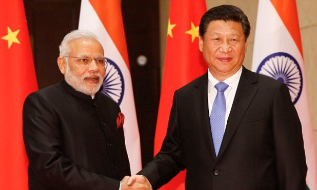 XI'AN, CHINA - MAY 14: (CHINA OUT) Indian Prime Minister Narendra Modi shakes hands with Chinese President Xi Jinping before a meeting on May 14, 2015 in Xi'an, China. Modi is on a three-day state visit to China. (Photo by Du Yang/CNSPHOTO/ChinaFotoPress via Getty Images)