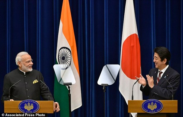 India's Prime Minister Narendra Modi, left, and Japan's Prime Minister Shinzo Abe attend a joint press conference at Abe's official residence in Tokyo, Japan, Friday, Nov. 11, 2016. After their bilateral meeting, both countries signed a civilian nuclear cooperation agreement that will allow Japan to export nuclear plant technology to India. (Franck Robichon/Pool Photo via AP)